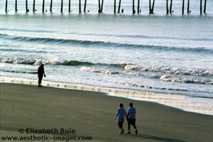 Early-morning walkers and prospector, Ocean Isle Beach, NC (copyright Elizabeth Buie)